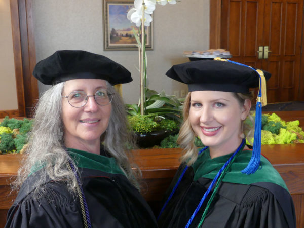 Dr. Mary Froeba and older woman in graduation cap and gown